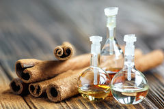 Essential oils. Essential oil in glass bottle with cinnamon sticks-beauty treatment. Spa concept. Selective focus Royalty Free Stock Image