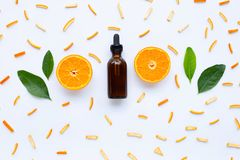 Essential oils with orange citrus fruits on white. Background stock images