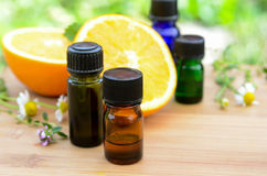Essential oils with orange and herbs. Essential oils for aromatherapy treatment with orange and herbs royalty free stock photo