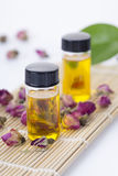 Essential oils. With rose buds on the table stock photo