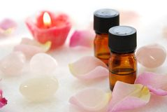 Essential oils with rose candle Royalty Free Stock Photography