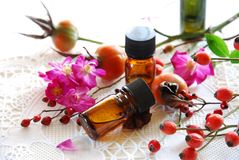 Essential oils with rose hips Stock Photo