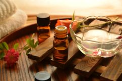 Essential oils and roses. Essential oils for aromatherapy treatment with roses Royalty Free Stock Image