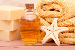 Essential oils spa decor. Spa decor with essential oils and towel Royalty Free Stock Images