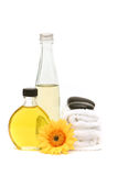 Essential oils and spa towels Stock Images