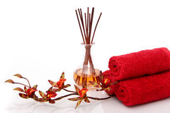 Essential oils, towels and orchid Royalty Free Stock Image