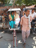 The Essential Rickshaw. The author and friend after enjoying a  timeless rickshaw ride in the rickety streets of India Royalty Free Stock Photography