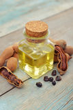 Essential tamarind oil with tamarind pods Royalty Free Stock Photos