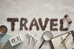 Essential things for traveller with Travel letter from coffee bean on the floor stock photos