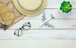 Essential travel items.The  tree map airplane eyeglasse Stock Photos
