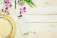 Essential travel summer items.The sunblock moisturizing. Top view essential travel summer items.The sunblock moisturizing  hat  sunglasses orchid on white Stock Photos