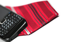 Essentials for a businessman. A necktie and a smartphone, essentials for a businessman Stock Images