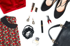 Essentials of feminine look - clothes, accessories, red and black. Female clothes and look essentials - silk blouse, red skirt, black high heels, black leather Stock Images