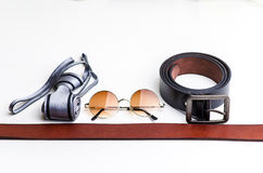 Essentials modern man glasses, tie and belt Stock Photography