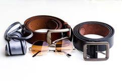 Essentials modern man glasses, tie and belt Royalty Free Stock Photos