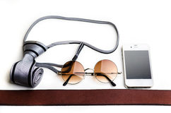 Essentials modern man glasses, tie, cellphone and belt Royalty Free Stock Photos