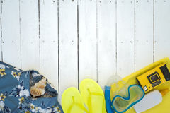 Essentials to go to the beach on summertime over a wooden background Royalty Free Stock Images
