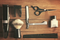 Essentials tools for barber. Overhead of barber tools on wood top Royalty Free Stock Photography