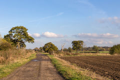 Essex countryside in autumn, newly ploughed field with farm trac Stock Images