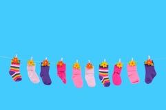 Essiccamento di molti calzini Immagini Stock Libere da Diritti