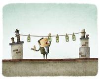 Essiccazione dei soldi sul tetto Fotografie Stock Libere da Diritti