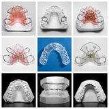 Essix retainer surrounded by orthodontic appliances and study models Royalty Free Stock Images
