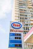 Esso Express petrol fuel station with large appartment building Royalty Free Stock Images
