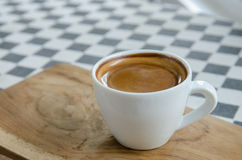 Esspresso coffee in a white cup on the table. Royalty Free Stock Photo