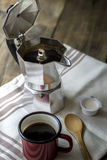 Esspresso pot and red coffee cup Royalty Free Stock Photo