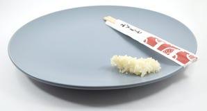Essstäbchen mit Reis Lizenzfreie Stockfotos