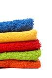 Essuie-main multicolores empilés Photographie stock