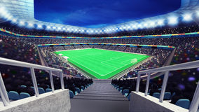 Estádio de futebol com os fãs da opinião do canto da escadaria Imagem de Stock