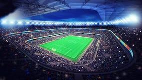 Estádio de futebol iluminado com os fãs nos suportes Imagem de Stock Royalty Free