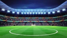 Estádio de futebol iluminado com os fãs nos suportes Imagens de Stock