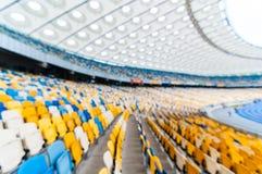 Estádio de futebol vazio borrado com suportes fundo de 2016 esportes Fotos de Stock Royalty Free