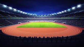 Estádio do atletismo com campo da trilha e de grama na opinião dianteira da noite Foto de Stock Royalty Free