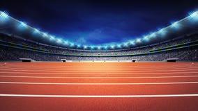 Estádio do atletismo com a trilha na opinião da noite do panorama Foto de Stock