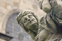 Estátua barroca original que descreve a avareza foto de stock