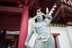 Estátua chinesa do deus no templo e no museu da relíquia do dente da Buda fotografia de stock