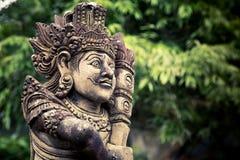 Estátua cinzelada pedra do balinese Fotos de Stock Royalty Free