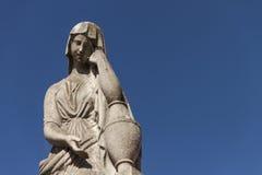 Estátua cristã da mulher no cemitério ou no Recoleta Imagens de Stock