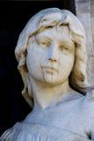 Estátua cristã da mulher no cemitério ou no Recoleta Fotografia de Stock