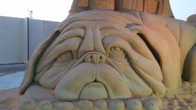 Estátua da areia do Pug Fotografia de Stock Royalty Free