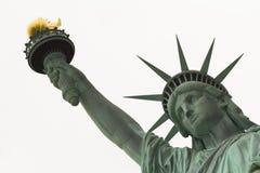 Estátua da liberdade próxima acima na face e no braço imagens de stock