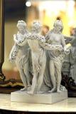 Estátua da porcelana das benevolências da antiguidade três imagens de stock royalty free