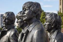 A estátua de Beatles em Liverpool foto de stock