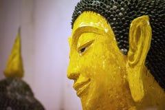 Estátua de brilho amarela de buddha da milha Fotos de Stock