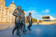 Estátua de bronze do Beatles no Merseyside em Liverpool, Reino Unido fotos de stock