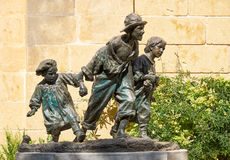 A estátua de Gavroshe nos jardins superiores de Barrakka, Valletta, Fotos de Stock Royalty Free