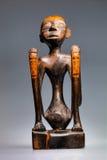 Estátua de madeira do menino, a ilha de Lombok Imagem de Stock